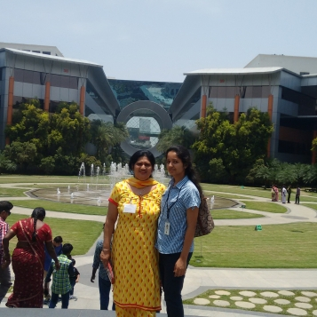 Showing around the campus to mom - the washing machine building just behind us.
