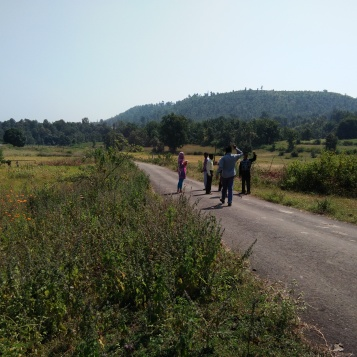 My colleagues walking on a scenic countryside road