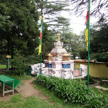 A stupa in the campus surrounded by trees