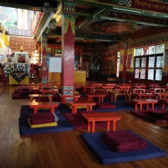 The gompa. The majestic statue of Lama Tsongkhapa can be seen as also the sitting arrangement for students