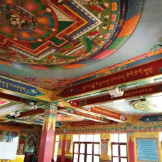 The entire gompa is covered in thangkas depicting various Buddhist themes. It was a very bright and colorful room